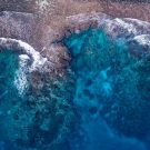 Oceans waves lapping coral reef