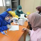 Patients receive medical tests in Indonesia