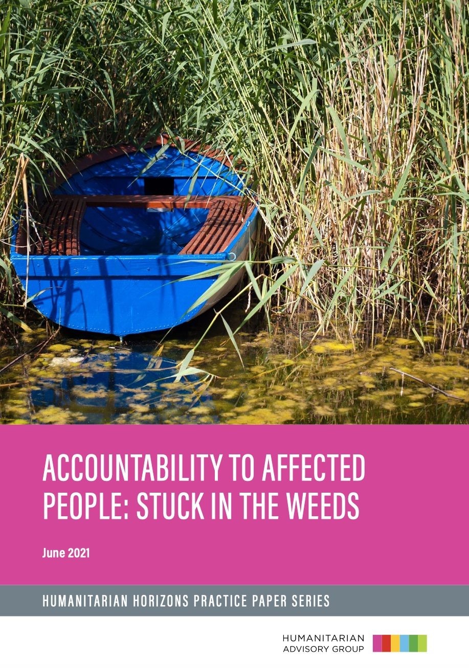 Accountability to affected people: stuck in the weeds. Boat on water partially in reeds.